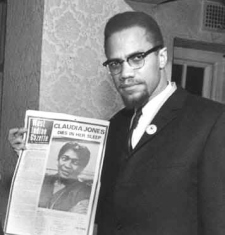 Malcolm X holding West Indian Gazette