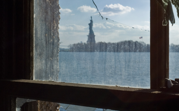 View of Statue of Liberty from Ellis Island detention window